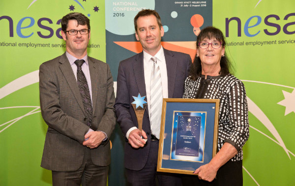 Martin Hehir, Deputy Secretary of the Department of Employment, who presented the award to Nick O'Callaghan and Wendy Dawson from Sodexo.